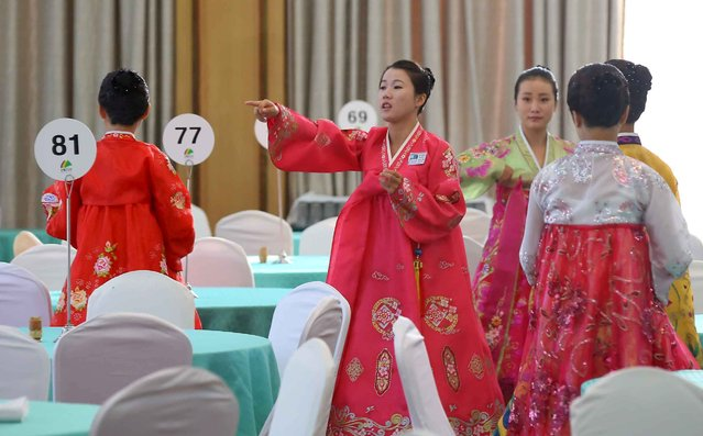 North Korean women prepare for a group luncheon during a reunion for separated families at Mount Kumgang resort, North Korea, October 21, 2015. (Photo by Reuters/Yonhap)