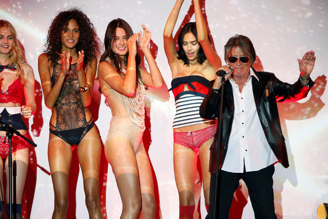 French actor and singer Jacques Dutronc (R) performs during the presentation of the Etam Live Show Lingerie at the Fashion Week in Paris, France, September 27, 2016. (Photo by Charles Platiau/Reuters)