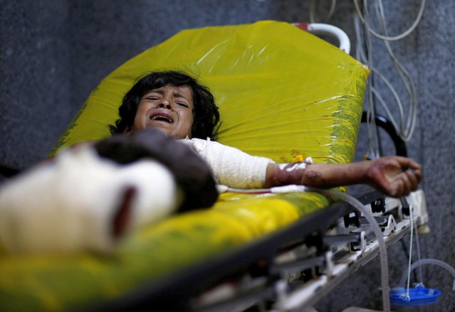 Manea Abdul-Latif Marzouq, 12, cries as he lies on a stretcher at a hospital in Sanaa after he was injured in an air strike in the northern province of al-Jawf, Yemen on July 15, 2020. Air strikes on Yemen's northern province of al-Jawf killed at least seven civilians, residents and an official from the Houthi movement said, in the third such incident since June as violence resurges in the war-damaged country. Violence has picked up since the expiry in late May of a temporary ceasefire prompted by the coronavirus pandemic, with the Houthis repeatedly staging missile and drone attacks on Saudi cities and the coalition retaliating with air strikes. (Photo by Khaled Abdullah/Reuters)