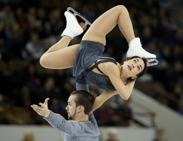 Ksenia Stolbova and Fedor Klimov of Russia perform during the pairs free skate program at the Skate America figure skating competition in Milwaukee, Wisconsin October 24, 2015. (Photo by Lucy Nicholson/Reuters)