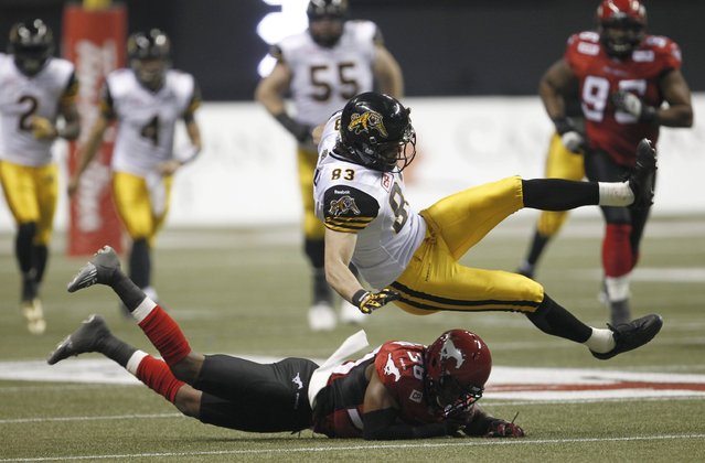 Calgary Stampeders' Buddy Jackson (38) tackles Hamilton Tiger Cats' Andy Fantuz in the first half during the CFL's 102nd Grey Cup football championship in Vancouver, British Columbia, November 30, 2014. (Photo by Andy Clark/Reuters)