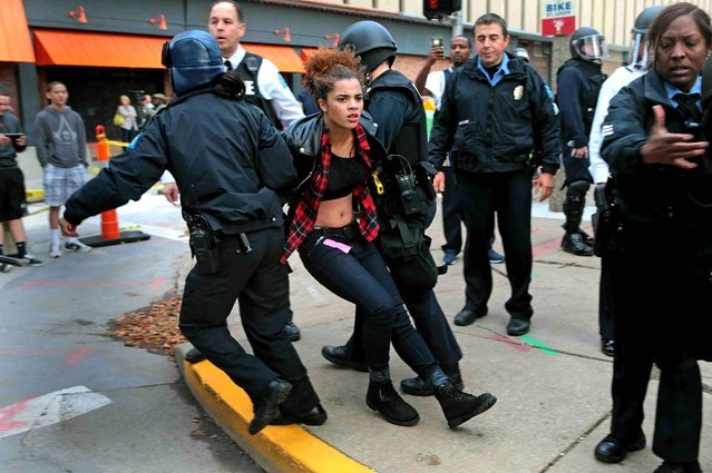 Police arrest a protester on Sunday, November 30, 2014, at Kiener Plaza, in St. Louis. Protesters and police clashed following an NFL football game between the St. Louis Rams and the Oakland Raiders as protests continued following a grand jury's decision not to indict a Ferguson police officer in the shooting death of Michael Brown. (Photo by Laurie Skrivan/AP Photo/St. Louis Post-Dispatch)
