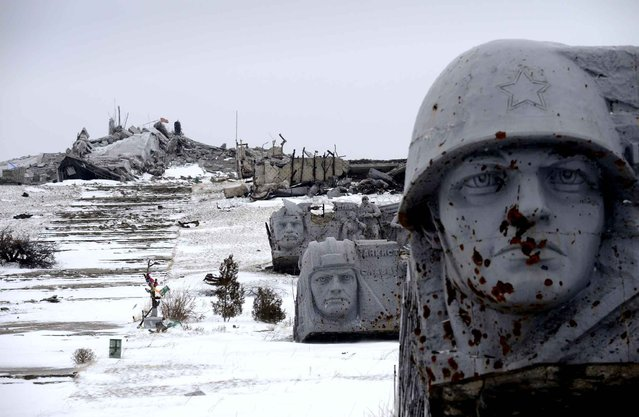 A photo taken on December 7, 2014 from the Savur Mogila monument to Red Army soldiers fallen during World War II near the eastern Ukrainian city of Snizhnee after a ceremony in memory of the pro-Russian rebels who have died during fighting against the Ukranian Army. (Photo by Eric Feferberg/AFP Photo)