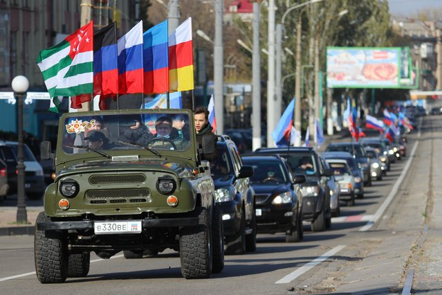 Vehicles take part in a motor rally marking Russia's Unity Day in a street in Lugansk, Ukraine on November 4, 2020. (Photo by Alexander Reka/TASS)