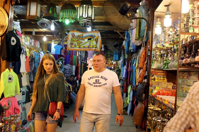 Tourists walk at a bazaar in Naama bay area in the Red Sea resort of Sharm el-Sheikh, November 7, 2015. (Photo by Asmaa Waguih/Reuters)
