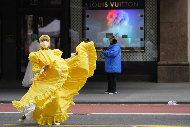 A dancer warms up along 34th Street while waiting to perform during a pre-taping of the Macy's Thanksgiving Day Parade in front of the flagship store in New York, Wednesday, November 25, 2020. (Photo by Mary Altaffer/AP Photo)