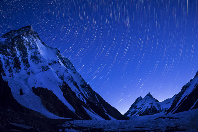 K2 mountain captured on a clear night just before sunrise. (Photo by David Kaszlikowski/Rex Features)