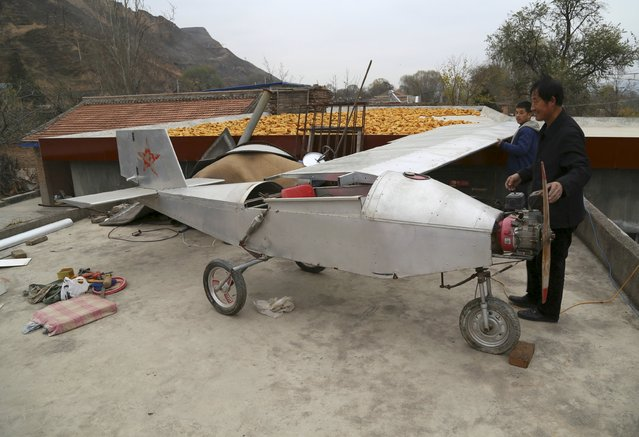 Chen Lianxue, 50-year-old farmer, builds his homemade plane on the roof of his house in Qifu village of Pingliang, Gansu province, China, November 22, 2015. The plane took Chen about 28,000 yuan ($4,381) and over two years time to make, local media reported. (Photo by Reuters/China Daily)