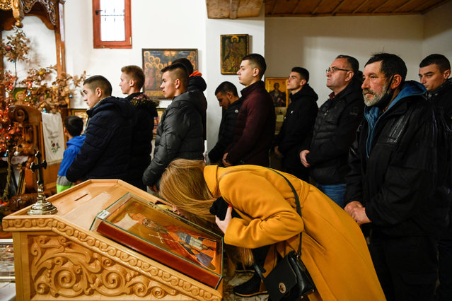 Kosovo Serb faithful attend a liturgy during Orthodox Christmas ceremony in the village of Gusterica on January 7, 2021. Serbian Orthodox believers celebrate Christmas according to the Julian calendar, which runs two weeks behind the Gregorian calendar. (Photo by Armend Nimani/AFP Photo)