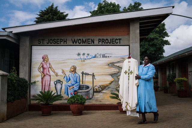 A parishioner of the St. Joseph the Worker Parish in Nairobi's Kangemi slum carries the vestments to be worn by Pope Francis during his visit to Kenya on November 24, 2015 in Kenya. Pope Francis makes his first visit to Kenya on a five day African tour that is scheduled to include Uganda and the Central African Republic. Africa is recognised as being crucial to the future of the Catholic Church with the continent's Catholic numbers growing faster than anywhere else in the world. (Photo by Nichole Sobecki/Getty Images)