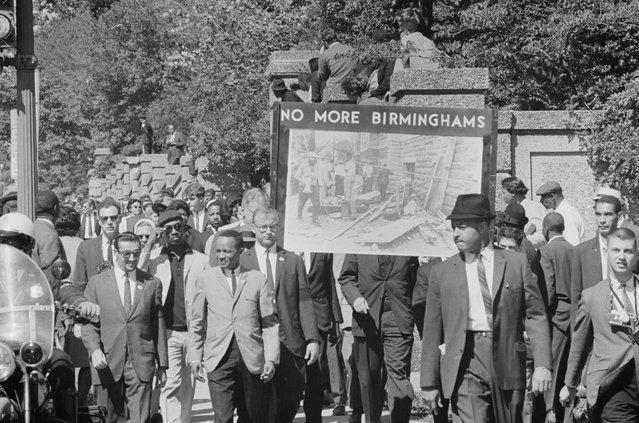 "Congress of Racial Equality members conduct a march in memory of those killed in the Birmingham bombings, carrying a sign that says ""No More Birminghams"" in Washington D.C., September 22, 1963. (Photo by Reuters/Library of Congress)"