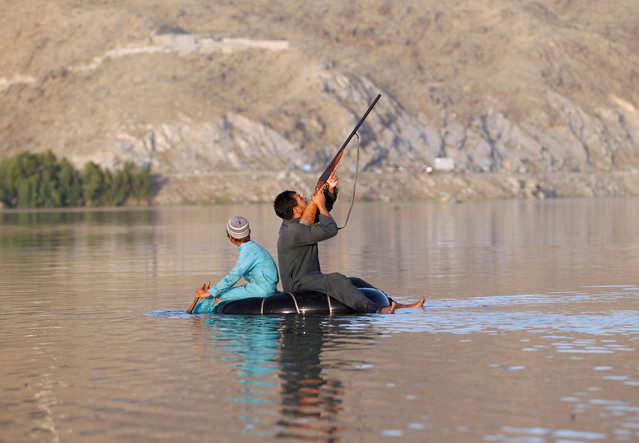 An Afghan hunter shoots at a duck in Laghman province, Afghanistan on May 30, 2018. (Photo by Reuters/Parwiz)