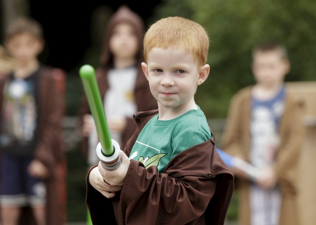 "A young guest participates in the revamped ""Jedi Training : Trials of the Temple"" attraction during the Star Wars Launch Bay grand opening at Disney's Hollywood Studios in Orlando, Florida December 4, 2015. (Photo by Scott Audette/Reuters)"