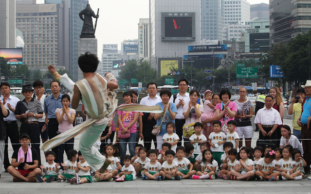 A South Korean Taekwondo expert performs martial arts during an event for tourists in Seoul, South Korea, Wednesday, June 26, 2013. (Photo by Ahn Young-joon/AP Photo)