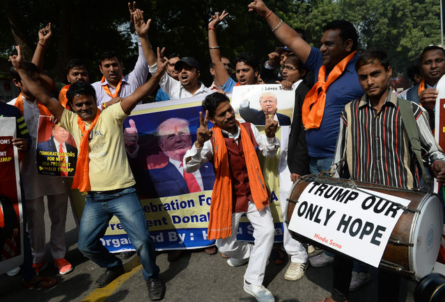 Members of Hindu Sena, a right-wing Hindu group, celebrate Republican presidential nominee Donald Trump's victory in the U.S. elections, in New Delhi, India, November 9, 2016. (Photo by Prakash Singh/AFP Photo)