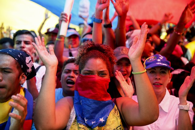 Opposition supporters march during a protest against shortages of basic goods in Caracas January 24, 2015. (Photo by Jorge Silva/Reuters)