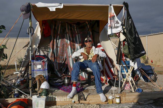 "Richey Luper, from Newport Beach, California, sits outside his tent at Camp Hope in Las Cruces, New Mexico October 7, 2015. ""This is good ...The tent city gives a sense of safety. No doubt about it"", Luper said. Camp Hope describe themselves as an ""alternative transitional living project for the homeless"". (Photo by Shannon Stapleton/Reuters)"