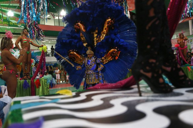 A participant attends a carnival luxurious costume contest during the Glam Gay pre-carnival Ball, in Mangueira samba school in Rio de Janeiro February 11, 2015. (Photo by Ricardo Moraes/Reuters)