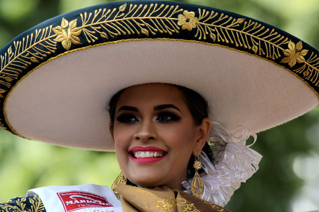 A woman takes part in the 25 th International Mariachi Festival in Guadalajara, Mexico on August 26, 2018. Mariachi music has been acknowledged by UNESCo as Intangible Cultural Heritage of Humanity. (Photo by Ulises Ruiz/AFP Photo)