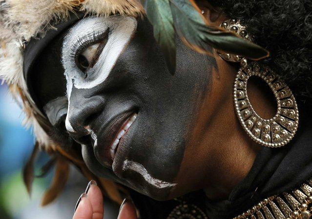 A member of the Zulu Social Aid and Pleasure Club parades down St. Charles Avenue on Mardi Gras in New Orleans, Louisiana February 17, 2015. (Photo by Jonathan Bachman/Reuters)