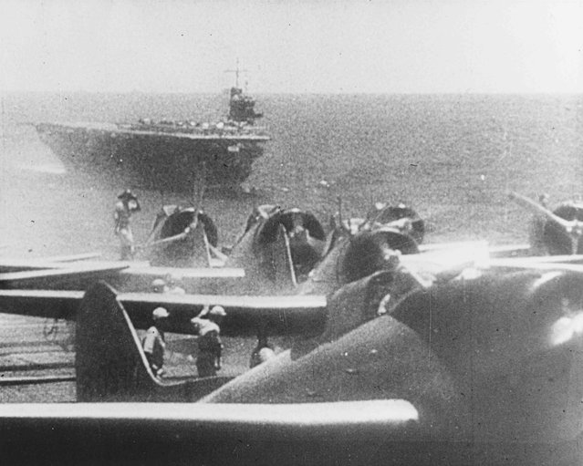 Japanese Navy Type 99 Val carrier bombers prepare to take off from an aircraft carrier to attack Pearl Harbor, Hawaii, U.S. December 7, 1941. The ship in the background is the carrier Soryu. (Photo by Reuters/U.S. Navy/National Archives)