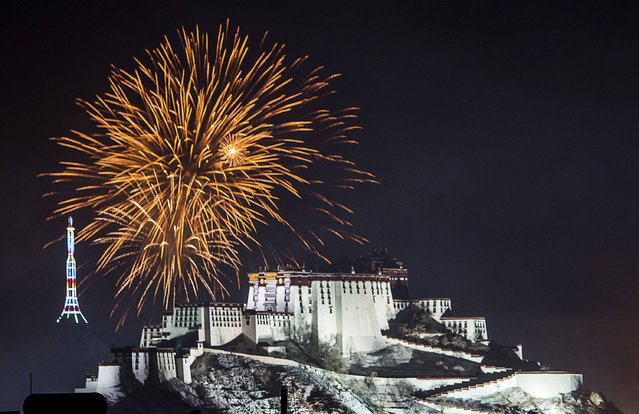 Fireworks explode above the Potala Palace during the celebration of the Tibetan New Year, in Lhasa, Tibet Autonomous Region, February 19, 2015. (Photo by Reuters/Stringer)