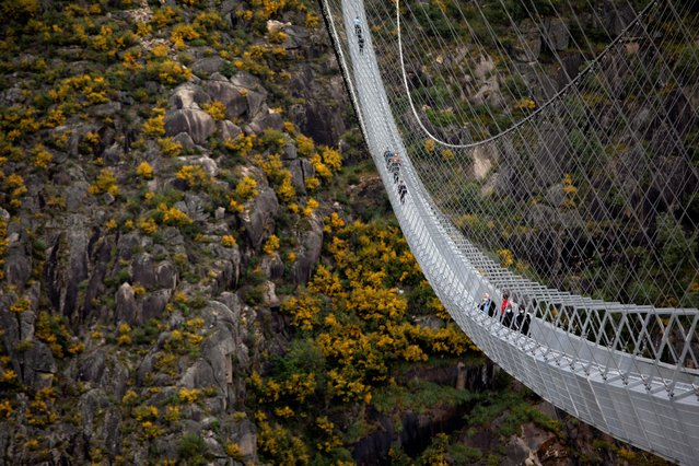 "People walk on the world's longest pedestrian suspension bridge ""516 Arouca"", now open for local residents in Arouca, Portugal, April 29, 2021. (Photo by Violeta Santos Moura/Reuters)"