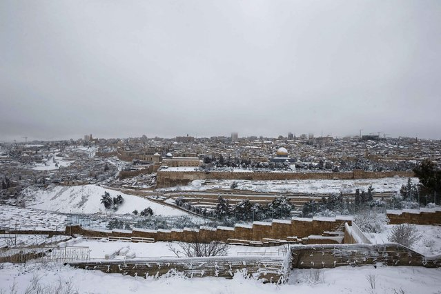 A general view shows the snow-covered Dome of the Rock in the compound known to Muslims as Noble Sanctuary and to Jews as Temple Mount, in Jerusalem's Old City, as seen from the Mount of Olives February 20, 2015. (Photo by Ronen Zvulun/Reuters)