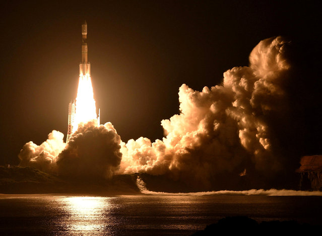 A HIIB rocket carrying a HII Transport vehicle takes off from the Tanegashima Space Center in Kagoshima Prefecture, Japan in this photo taken by Kyodo September 23, 2018. (Photo by Kyodo News via Reuters)