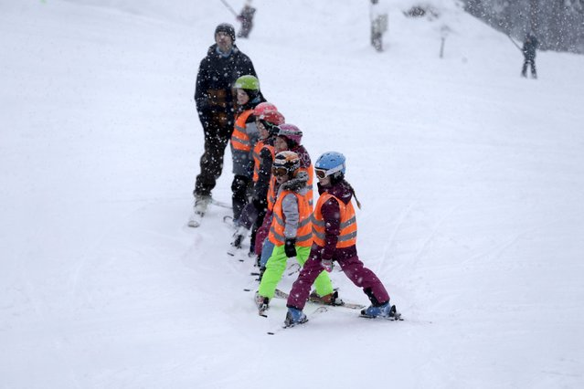Children attend alpine skiing lesson during World Snow Day event in Sigulda, Latvia, January 17, 2016. (Photo by Ints Kalnins/Reuters)