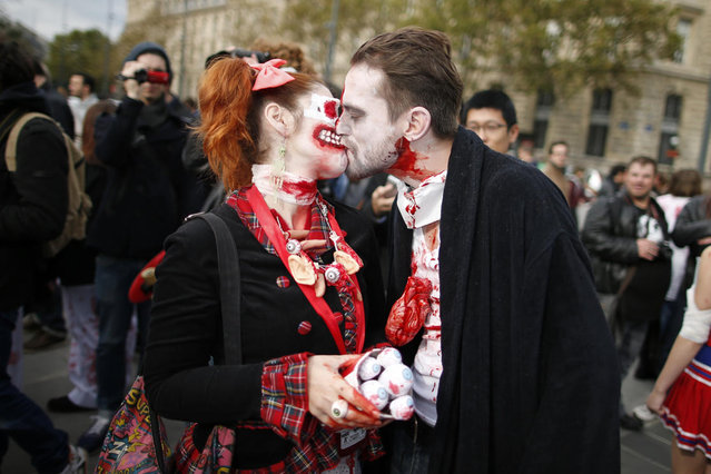 A couple dressed as zombies participates in a Zombie Walk procession in the streets of Paris October 12, 2013. (Photo by Benoit Tessier/Reuters)