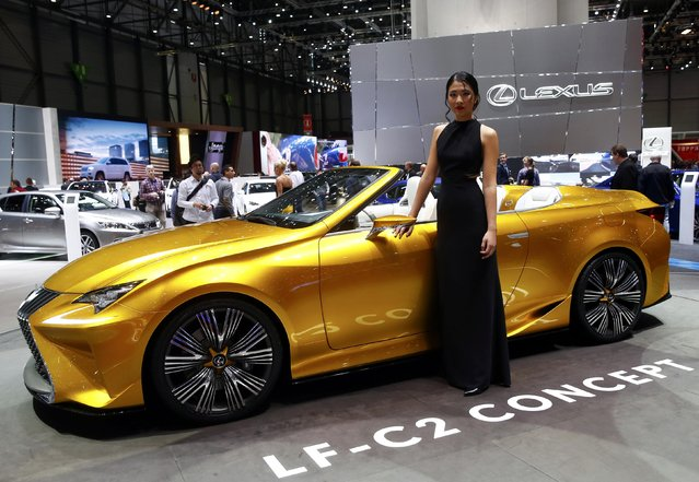 A model poses next to the Lexus LF-C2 concept car during the second press day ahead of the 85th International Motor Show in Geneva March 4, 2015. REUTERS/Arnd Wiegmann