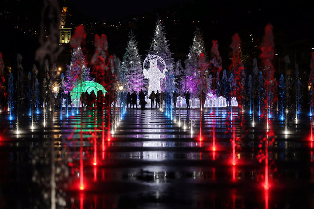 Colored lights are seen on a fountain as part of illuminations for the Christmas holiday season in Nice, France, December 5, 2016. (Photo by Eric Gaillard/Reuters)