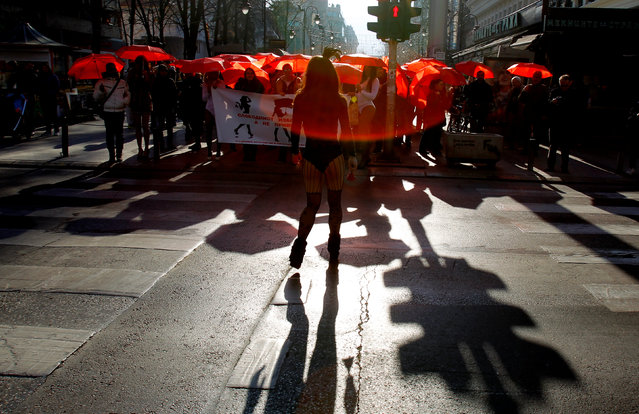 People carrying red umbrellas participate in a march to raise public awareness on human rights issues for s*x workers on the International Day to End Violence Against s*x Workers in Skopje, Macedonia December 17, 2016. (Photo by Ognen Teofilovski/Reuters)