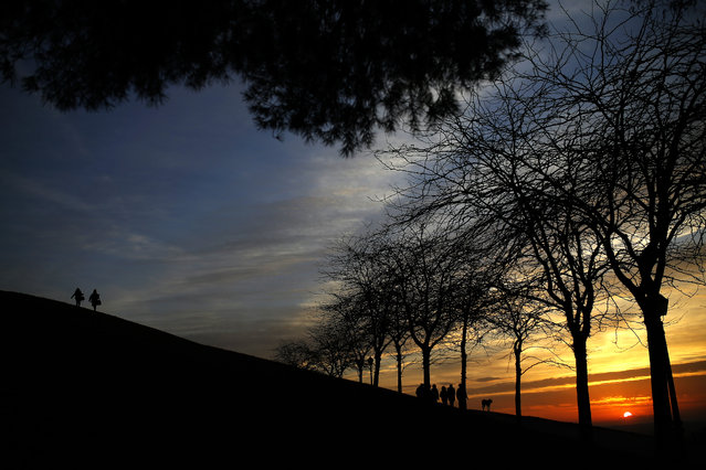 People stroll alongside one of the hills of the Tio Pio park in Madrid, Monday, January 25, 2016. The park is a high viewpoint frequented mostly by locals due to its view of the  Spanish capital skyline. (Photo by Francisco Seco/AP Photo)