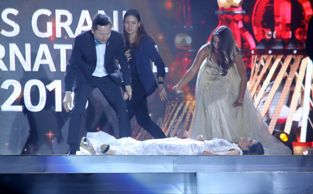 In this October 25, 2018 photo, Miss Paraguay Clara Sosa lies on stage after she fainted following the announcement that she won as Miss Grand International 2018 during the pageant's coronation night held in Yangon, Myanmar. (Photo by AP Photo/Stringer)