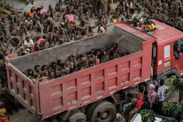 Wounded captive Ethiopian soldiers arrive on a truck at the Mekele Rehabilitation Center in Mekele, the capital of Tigray region, Ethiopia, on July 2, 2021. (Photo by Yasuyoshi Chiba/AFP Photo)