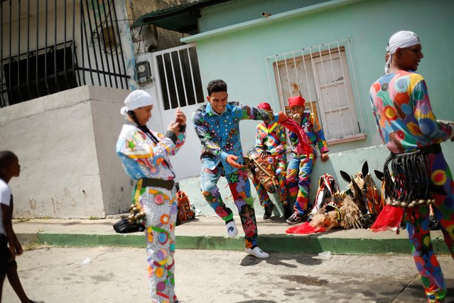 "A member of Venezuelan brotherhood ""Dancing Devils"" dances during their annual Corpus Christi celebration with a call for the end of the coronavirus disease (COVID-19), in Naiguata, Venezuela on June 3, 2021. (Photo by Leonardo Fernandez Viloria/Reuters)"