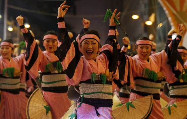 Dancers from the Shin Kotoni Tenburyujin in Japan take part in a Lunar New Year parade in Hong Kong, China February 8, 2016 to celebrate the first day of the Lunar New Year of the Monkey. (Photo by Bobby Yip/Reuters)