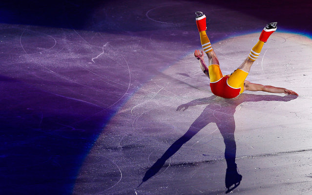 Javier Fernandez of Spain lies on the ice as he performs at the gala exhibition during the ISU Grand Prix of Figure Skating in Tokyo November 10, 2013. (Photo by Issei Kato/Reuters)