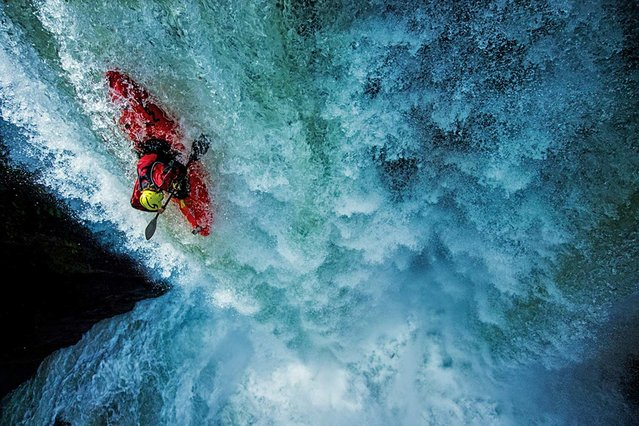 """This is the critical moment when everything goes right or everything goes wrong"", said extreme kayaker Tyler Brandt, describing this shot of him – an online Extreme Photo of the Week – going over the 65-foot Tomata 1 waterfall in Tlapacoyan, Mexico. It's important for waterfall kayakers to land precisely, an outcome influenced by their actions at the lip of the waterfall and into the first 20 feet of free fall. ""At this moment"", explained Brandt, ""I was focused on setting my angle correctly"". (Photo by Tim Kemple/National Geographic)"