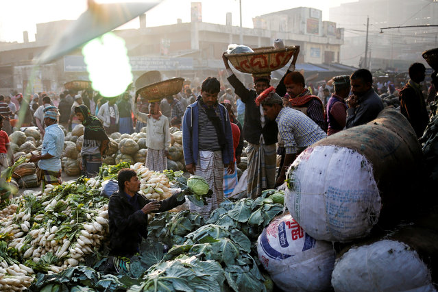 A vendor sells vegetables at Kawran Bazar in Dhaka, Bangladesh January 25, 2017. (Photo by Mohammad Ponir Hossain/Reuters)