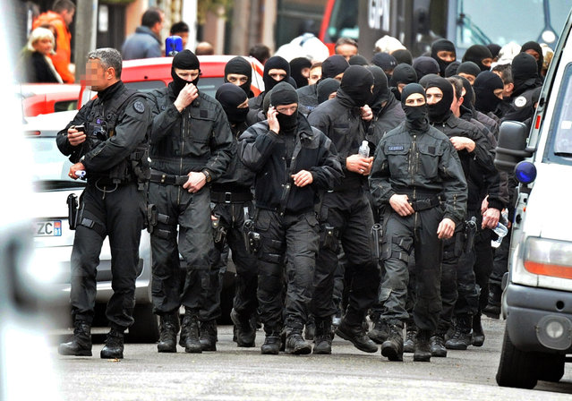 French members of the RAID special police forces unit leave after the assault on the besieged flat of self-professed Al-Qaeda militant Mohamed Merah, on March 22, 2012 in Toulouse, southwestern France. (Photo by Pascal Pavani/AFP Photo)