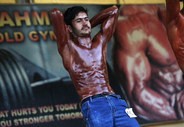 A participant poses during a local bodybuilding and fitness championship in Karachi, Pakistan March 13, 2016. (Photo by Akhtar Soomro/Reuters)