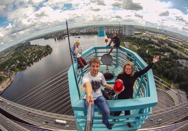 Yaroslav Segeda takes a selfie of himself and friends on top of the Moscow Bridge in Kiev. (Photo by Yaroslav Segeda/Solent News)