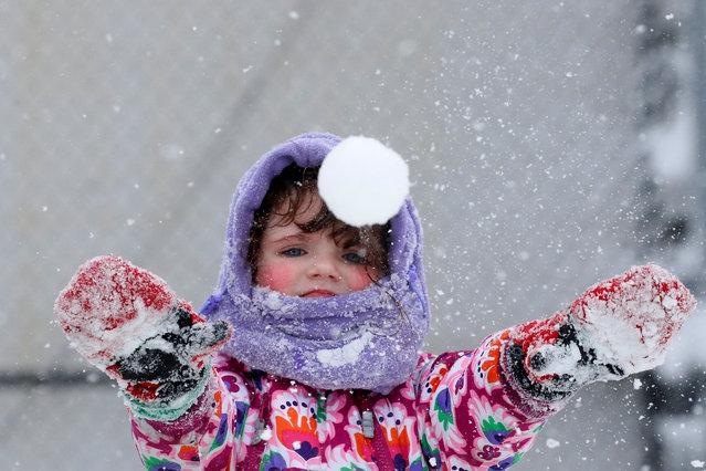Genia Sandley plays in the snow in Brooklyn, New York City, U.S., February 9, 2017. (Photo by Brendan McDermid/Reuters)