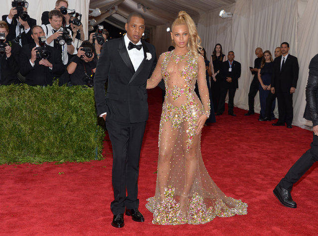 "Jay-Z, left, and Beyonce arrive at The Metropolitan Museum of Art's Costume Institute benefit gala celebrating ""China: Through the Looking Glass"" on Monday, May 4, 2015, in New York. (Photo by Evan Agostini/Invision/AP Photo)"