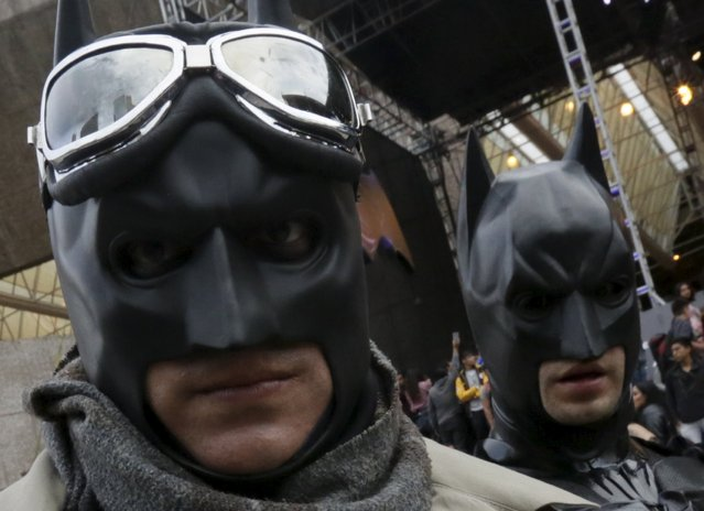 """Fans wear masks of """"Batman"""" as they wait for the arrival of cast members of the movie """"Batman v Superman: Dawn Of Justice"""" in Mexico City, Mexico, March 19, 2016. (Photo by Henry Romero/Reuters)"""