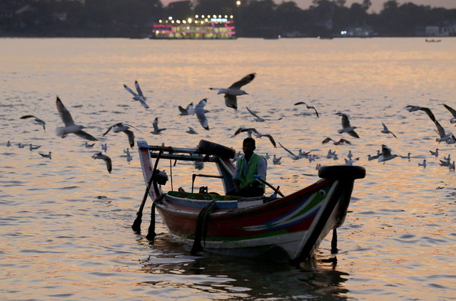 Seagulls fly overhead as a boat sails pass at the Botataung jetty on Yangon River, Yangon, Myanmar, 16 December 2018. (Photo by Nyein Chan Naing/EPA/EFE)