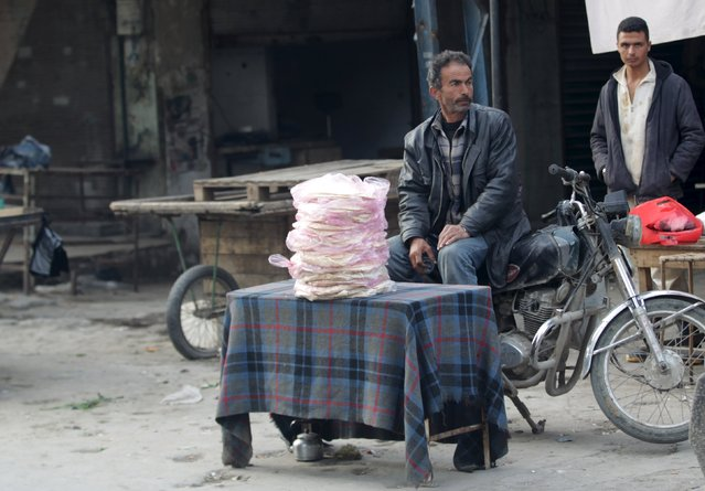 A man sells bread in the town of Marat Numan in Idlib province, Syria March 24, 2016. (Photo by Khalil Ashawi/Reuters)